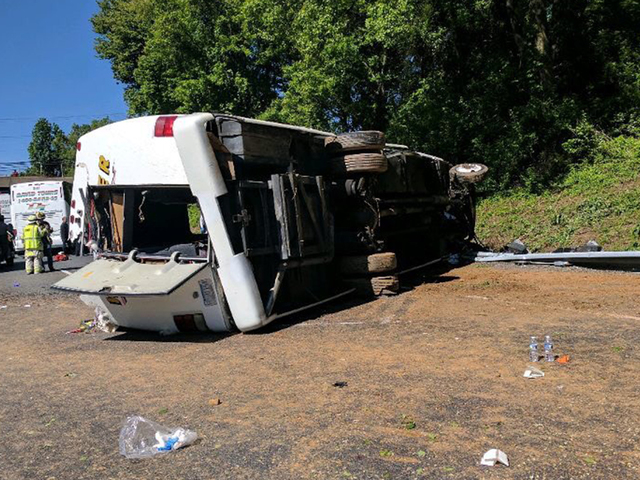 Tour bus carrying 26 children overturns on I-95 in Maryland